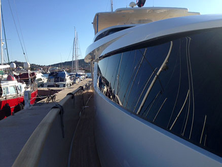 Dressing boat in a balloon (Nautimar Zadar). Yacht painting and boat care in Croatia.
